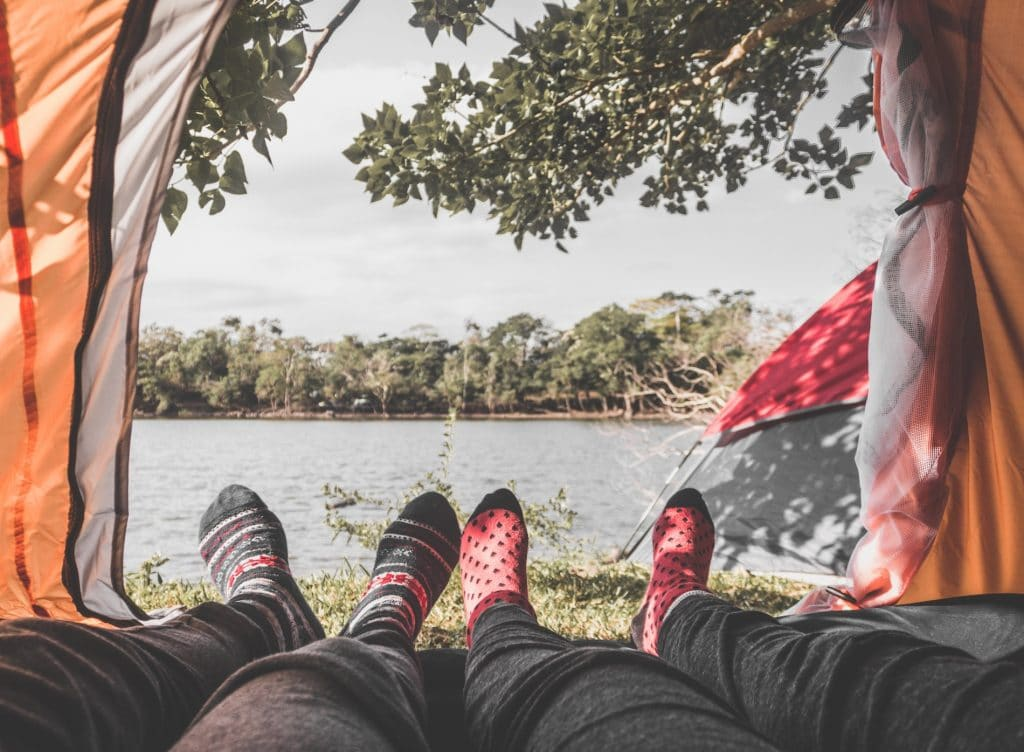 Wear wool socks and natural fibers while camping