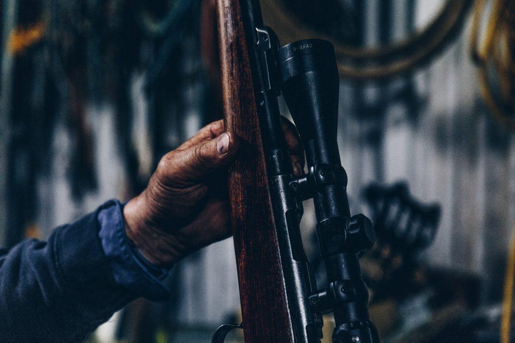 hand holding hunting rifle