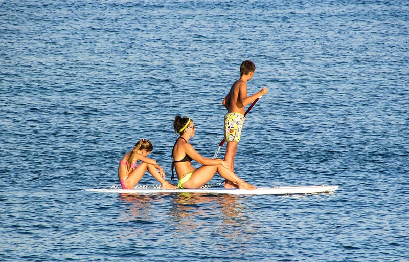Woman with two kids on a paddleboard