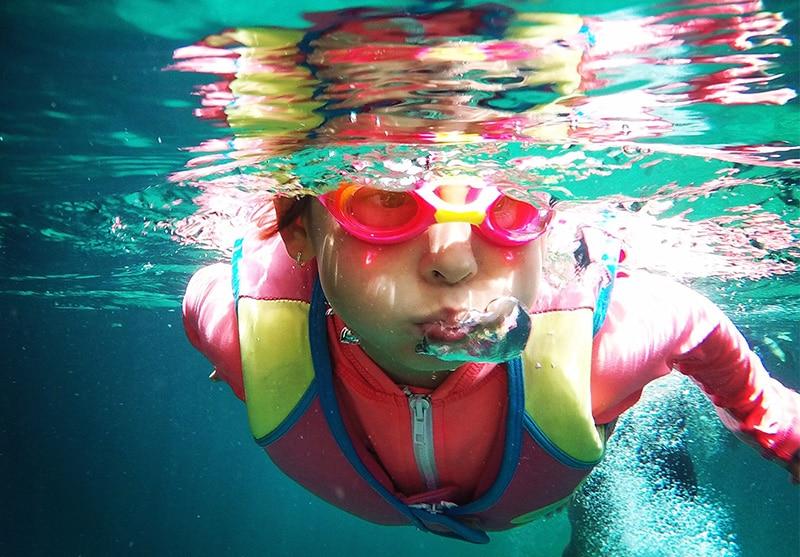 Child underwater wearing PFD