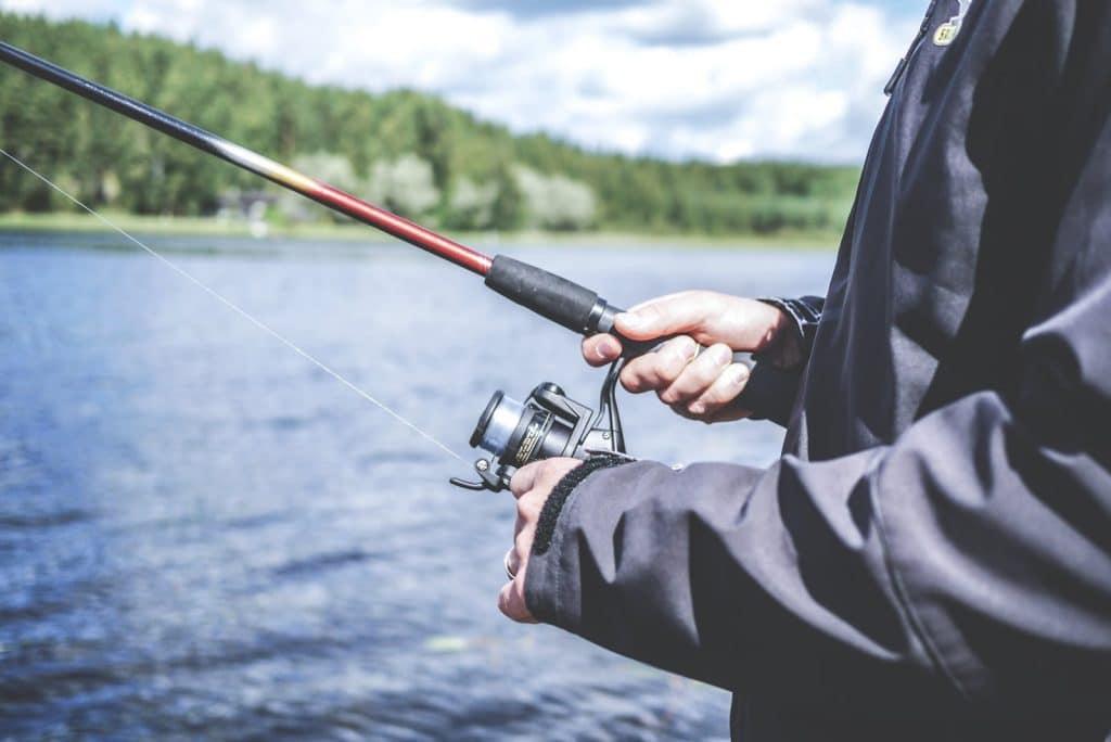 man holding bass fishing rod