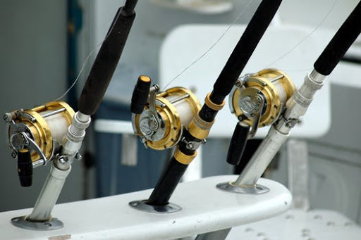 deep sea fishing rods in holders