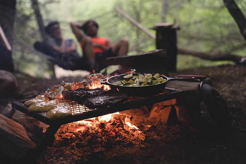 Grilling food at a campsite