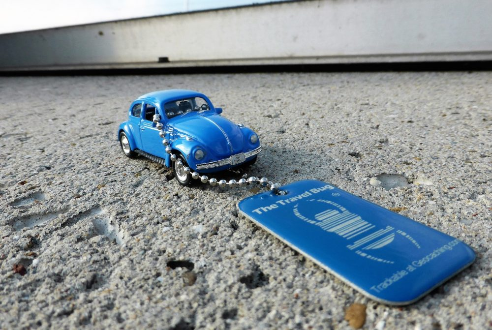 Geocache trackable travel bug attached to a miniature car