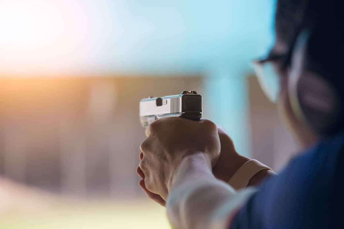 Man shooting at a gun range