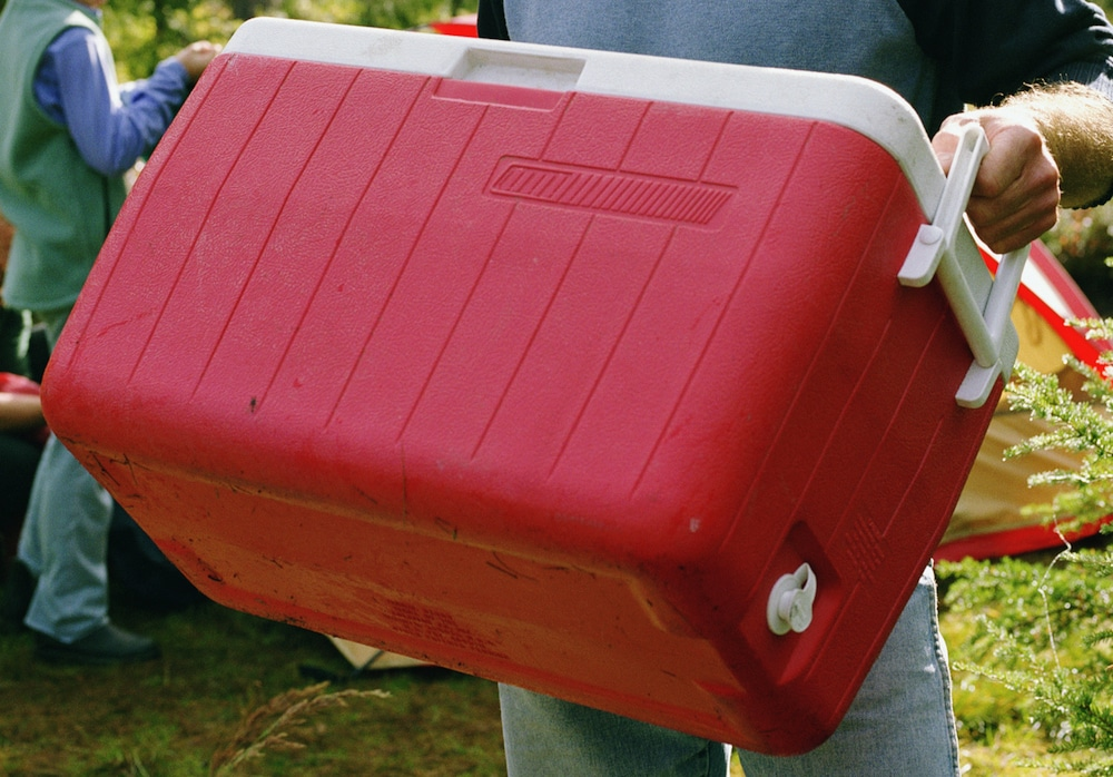 Man holding red cooler