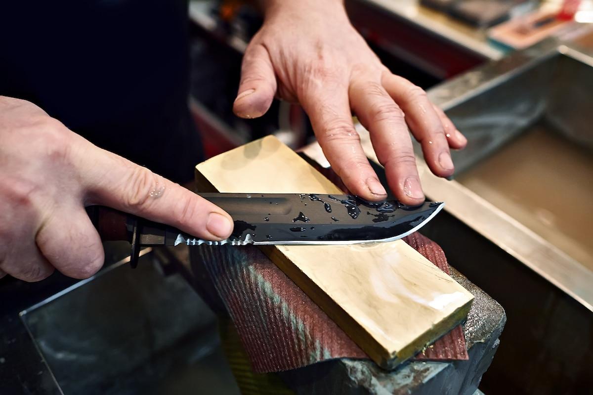 Knife sharpening manual work closeup