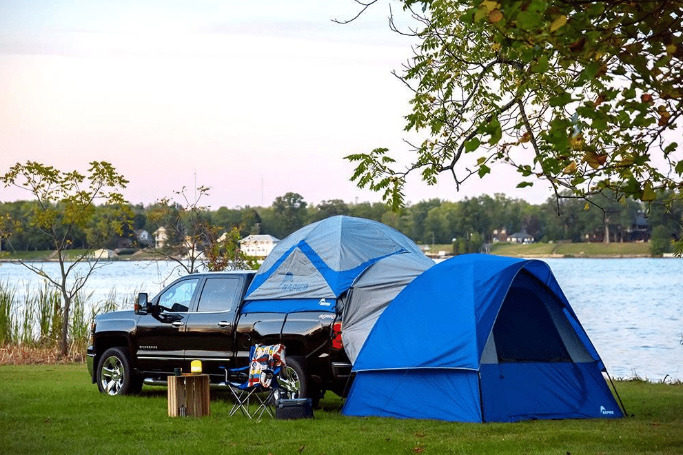 Camping in a truck with a truck bed tent and a ground attachment tent