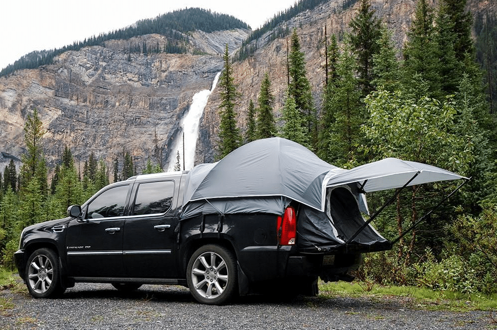 Black truck with a truck bed tent outdoors