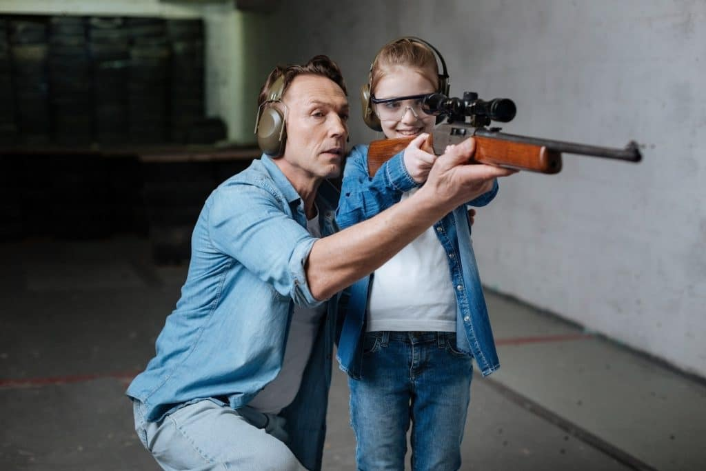 girl learning to shoot a 22 LR rifle