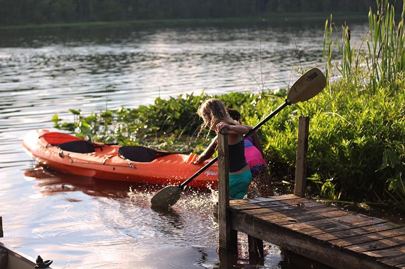Children kayaking on a spring camping trip in New York