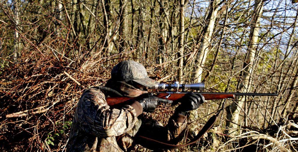 hunter taking aim with precision rifle