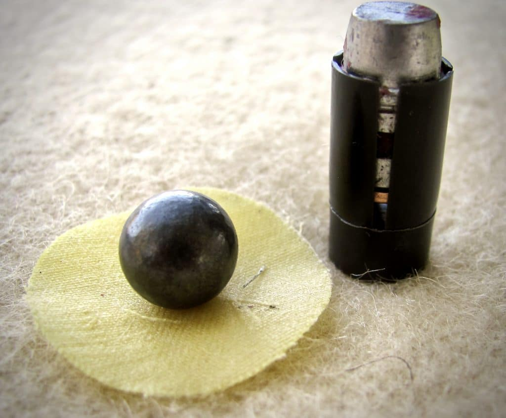 A patched round ball after shooting sabots makes cleaning easier