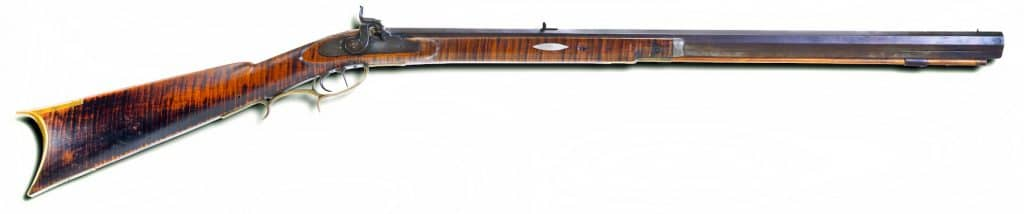 Antique percusion mountain rifle made around 1840-50's with tiger maple wood and double set triggers.