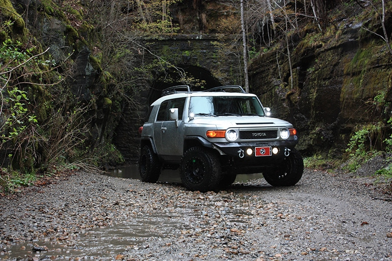 A secluded campsite with a 4x4 Toyota FJ in Georgia forest