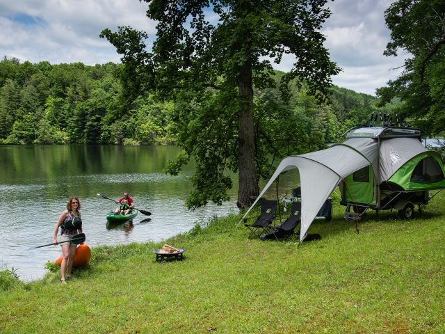 SylvanSport Go camper trailer setup at Lake Julia in Dupont State Forest, North Carolina.