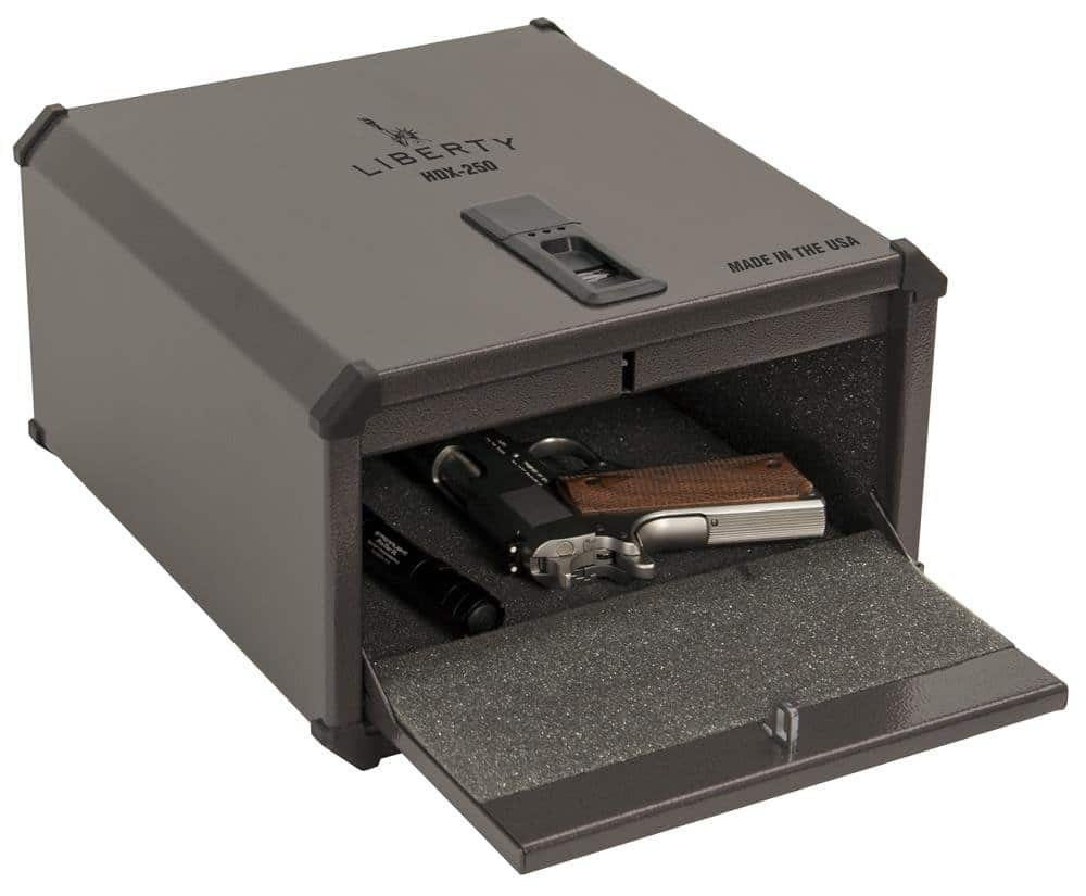 image of liberty safe with handgun and flashlight inside