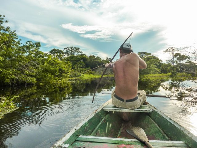 Bow hunting in the middle of the amazon rain forest in Brazil.