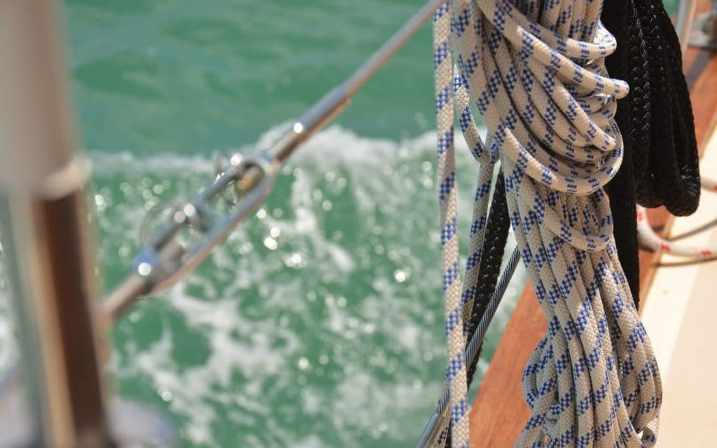 Blue and white rope on sailboat