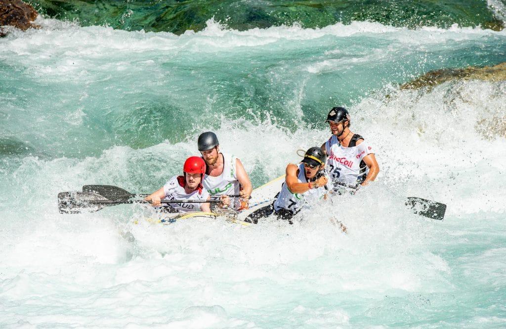 People enjoying a river raft trip.