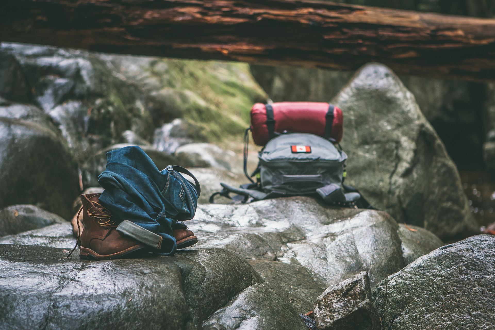 Backpacking gear by a river.