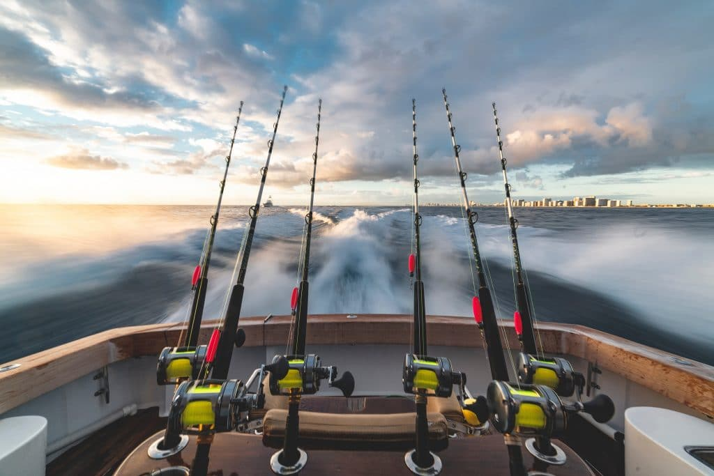 Fishing rods on a boat at sunrise