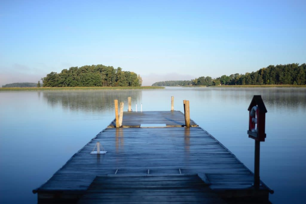 Wooden dock on a lake with blue sky
