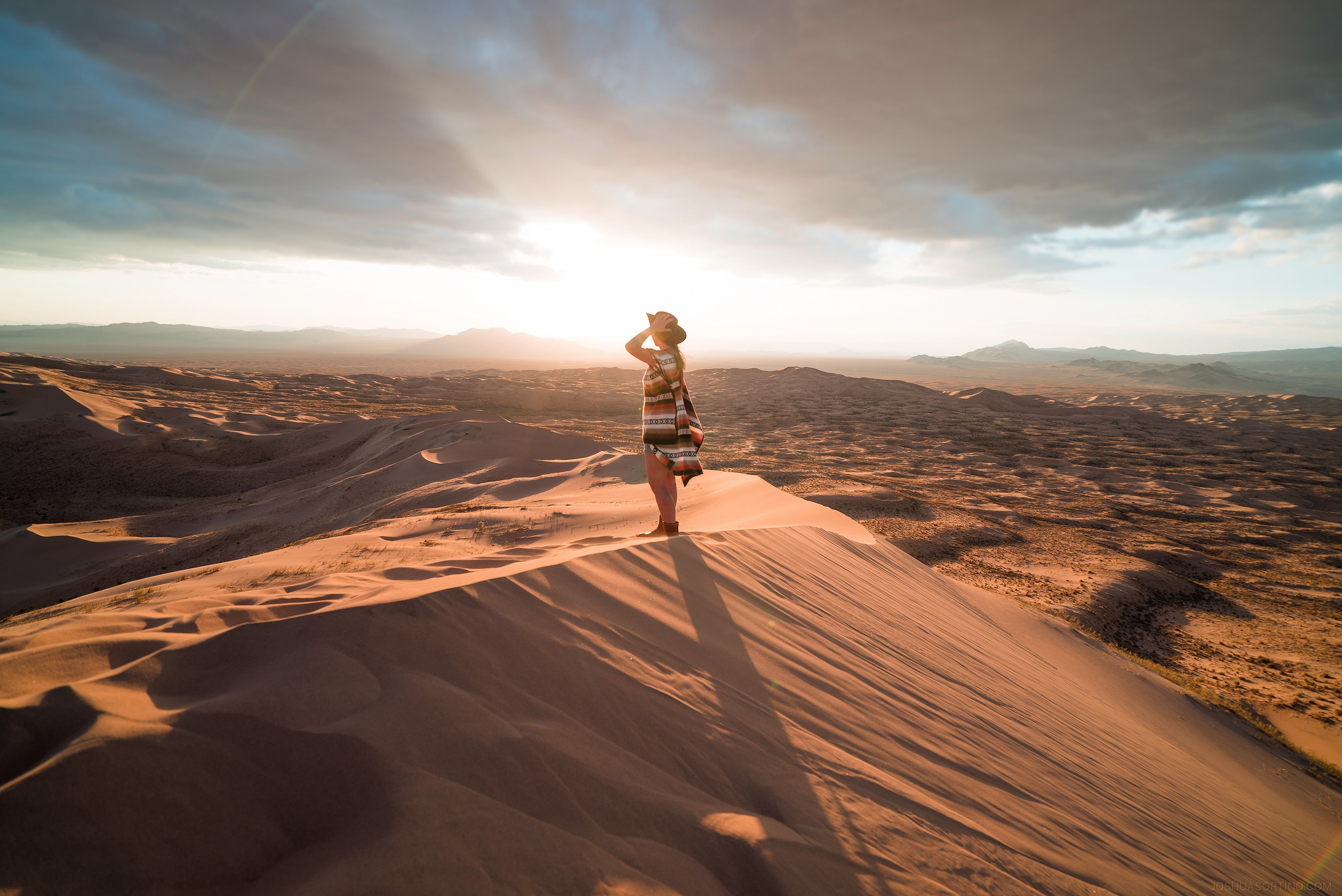 Woman Standing on Sand Dunes