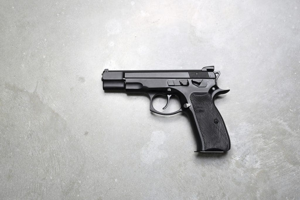 Gun on a gray background.
