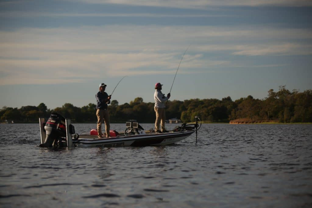 Two men fishing on bass boat