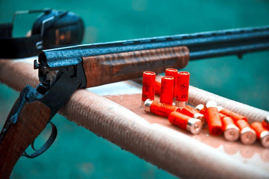 Hunting shotgun with bullets cartridges drop rain