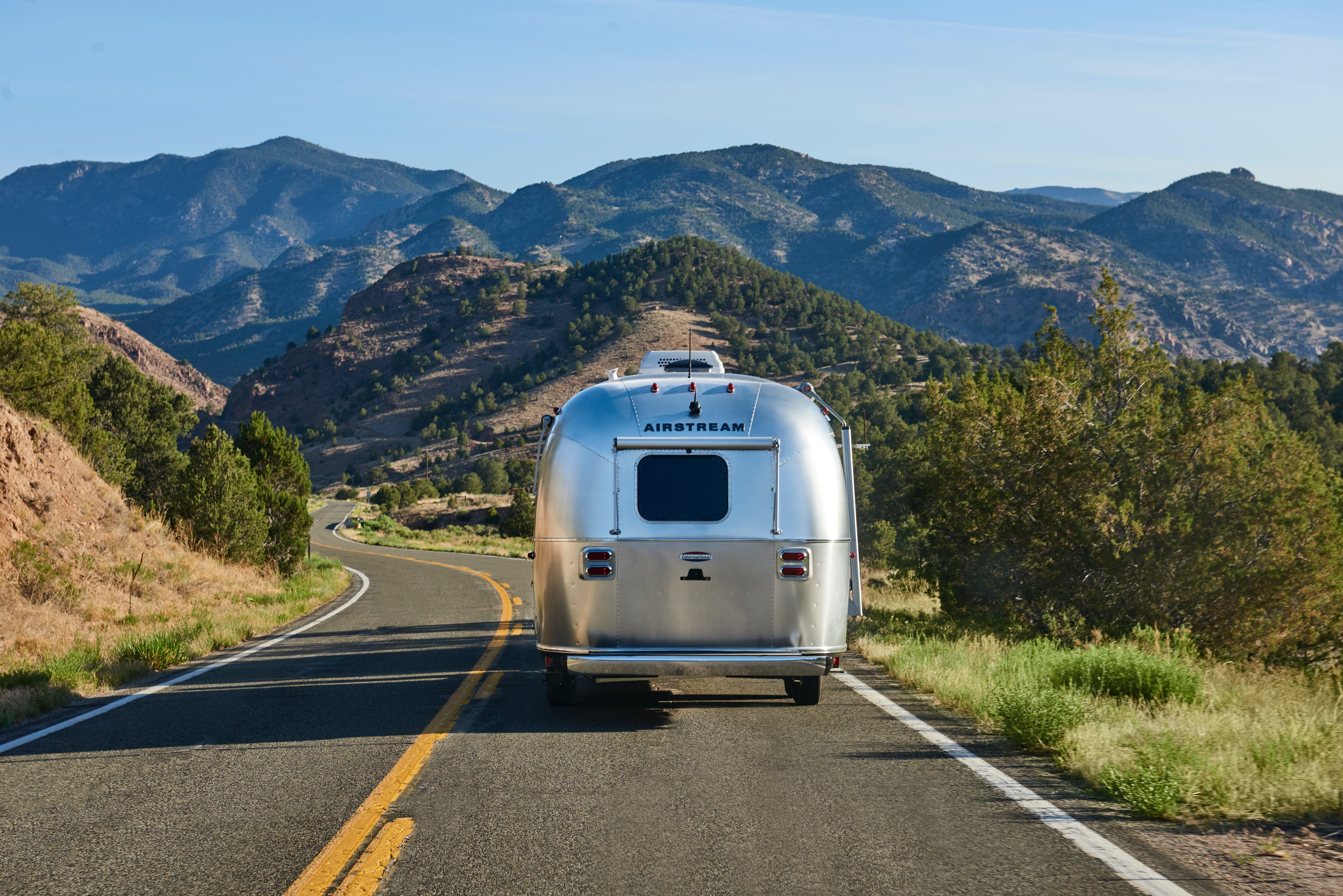 Airstream Heading Into Mountains
