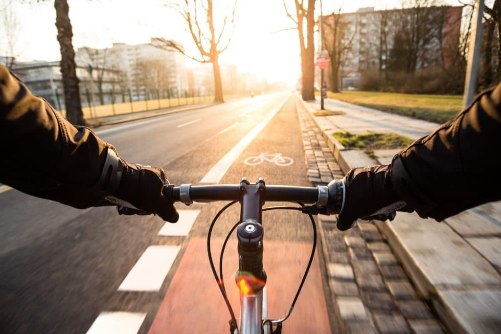 First-person view of cyclist in the city at morning