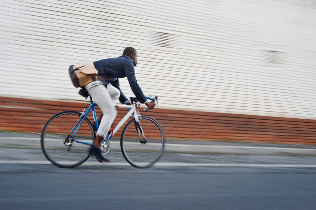 A young man commuting on his bicycle