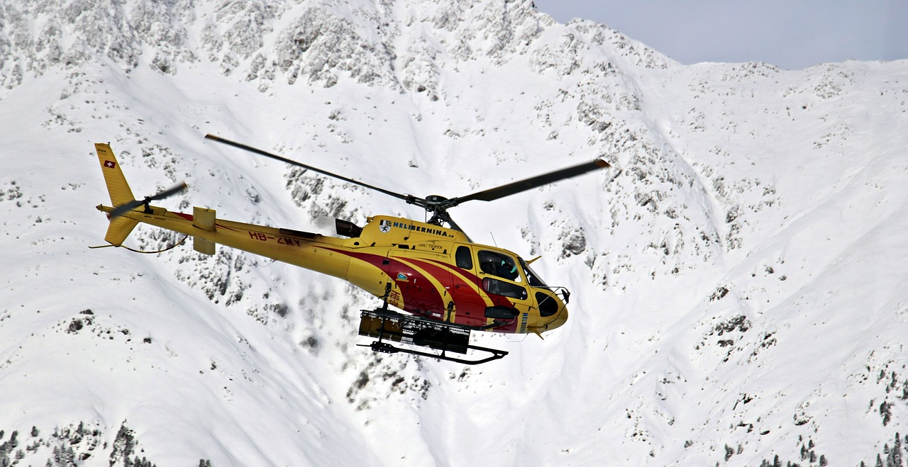 Emergency helicopter making a mountain rescue.