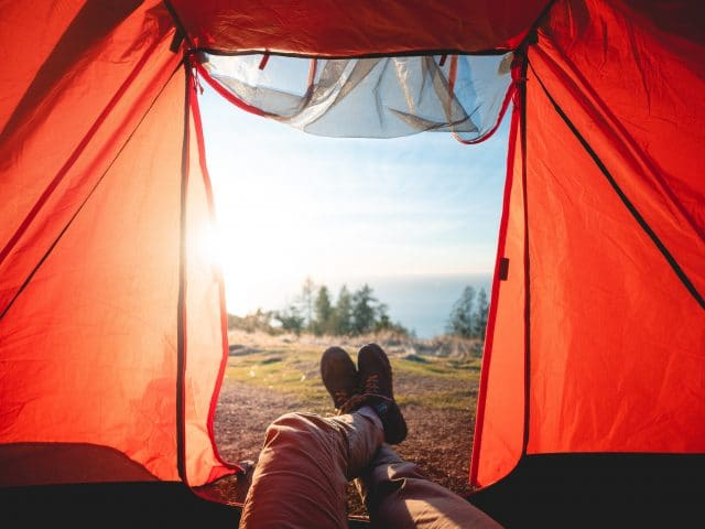 camping inside red tent