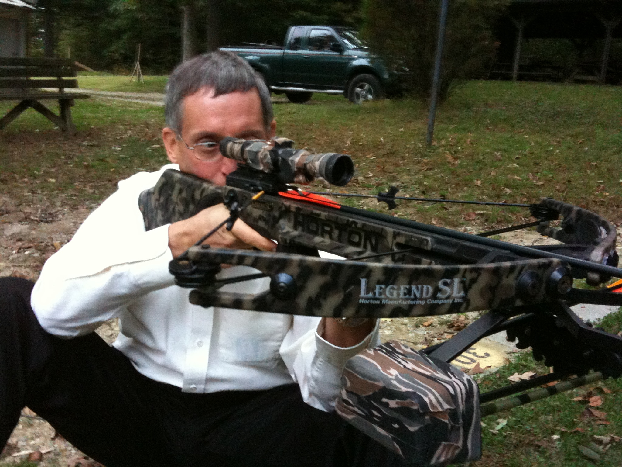Man Looking Through Crossbow Sight