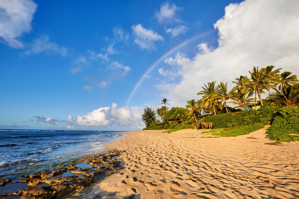 rainbow scenic view over the popular surfing place Sunset Beach, North Shore, Oahu, Hawaii, USA