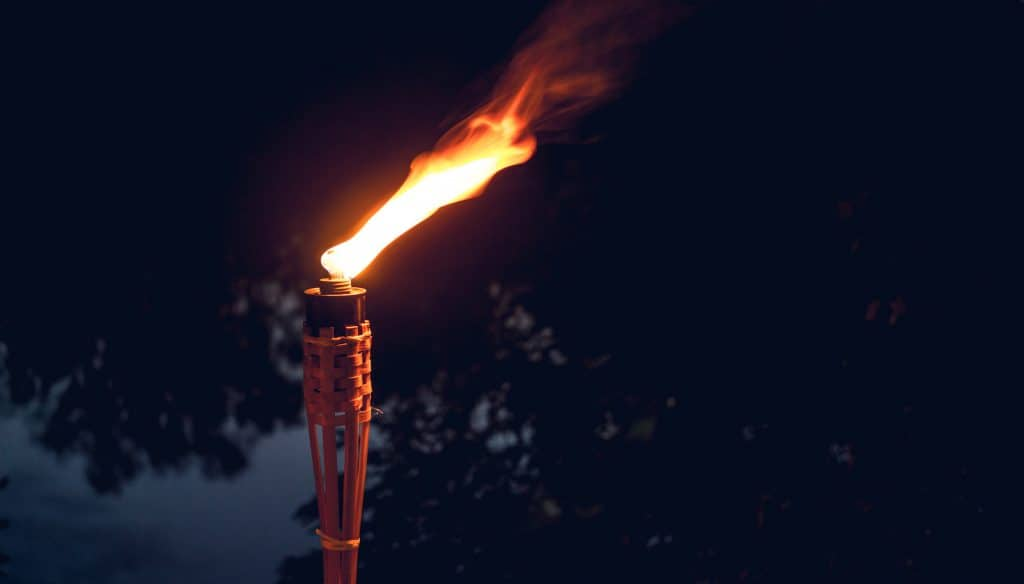Ceremonial lighting. Decorative ceremonial ritual burning torch. A holiday in the open air