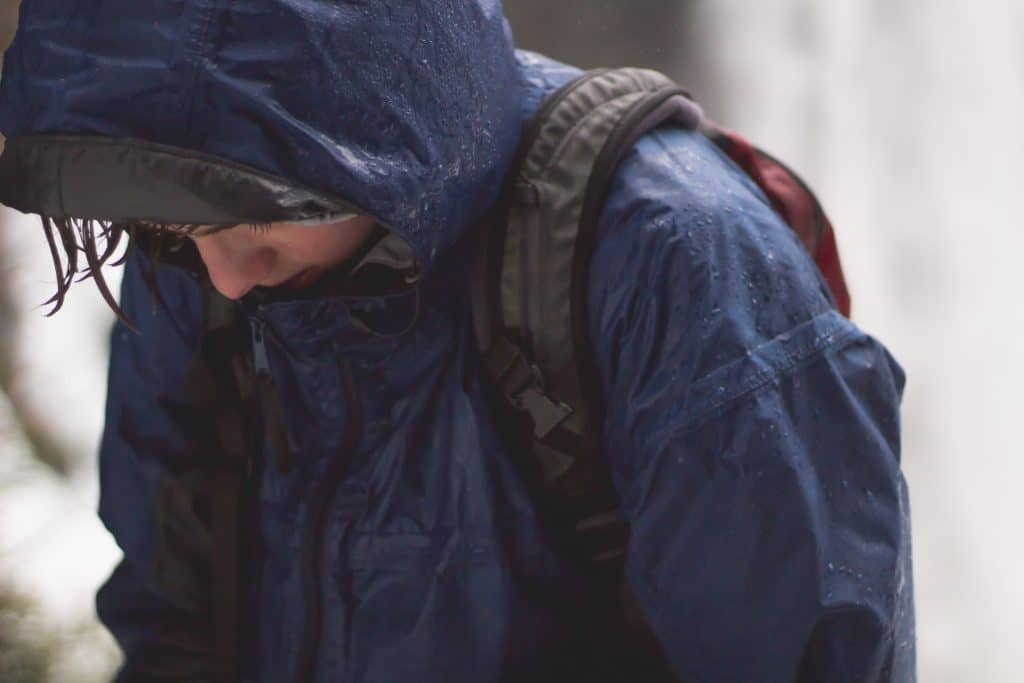 Hiker Wearing Raincoat Getting Wet in the Rain
