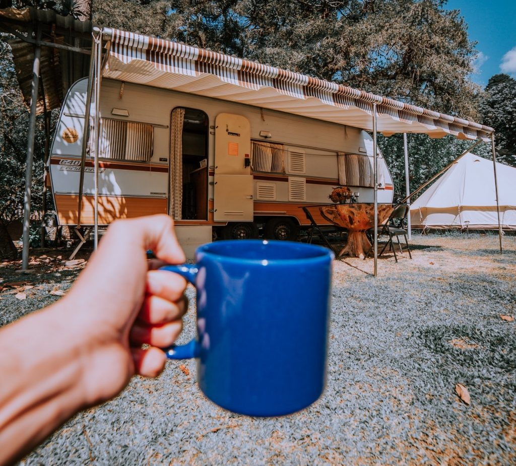 A person RVing and drinking coffee