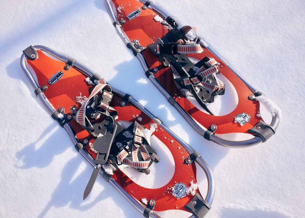 Orange composite snowshoes on snow