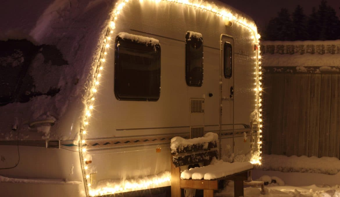 Winter camping holiday decorated garland. white Caravan