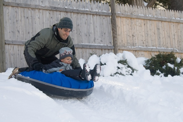 why a snow tube can make more sense than a sled - kids can ride with adults PC James Scott via Flickr