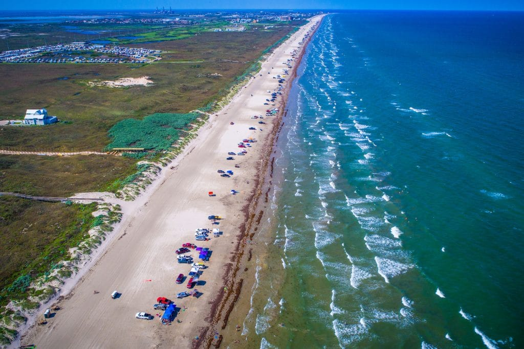 aerial drone view above Padre Island Long Beach near Corpus Christi , Texas on the Gulf Coast on a summer day with full sunshine