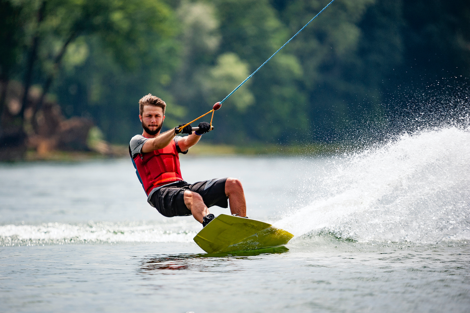 Wakeboarder on lake