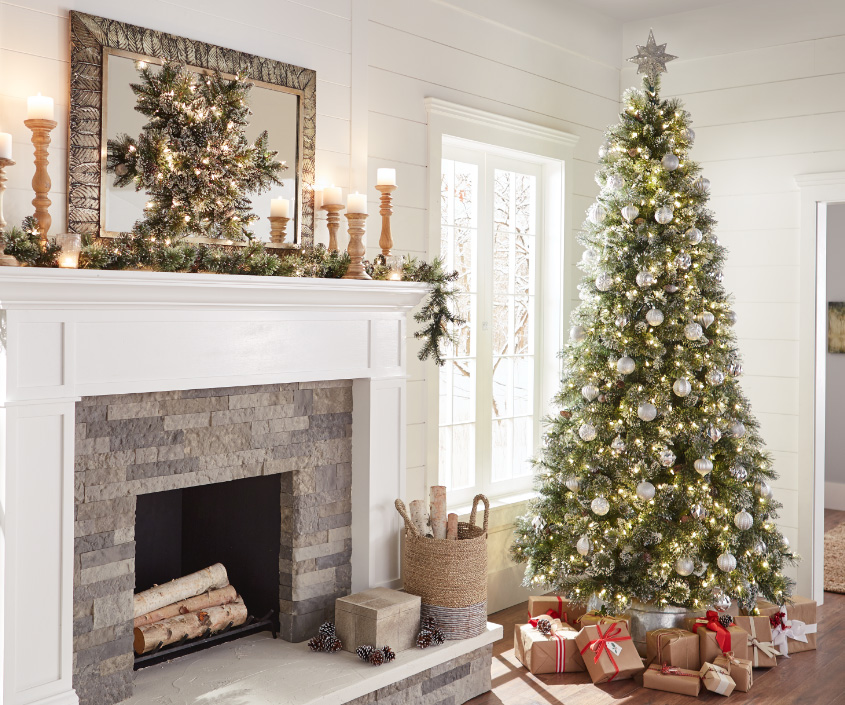living room with holiday tree