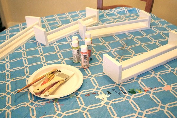 Kids paint spice racks for a DIY project