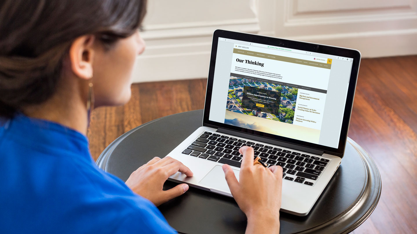 Digital Makeover: Customer browsing BNY Mellon redesigned website on laptop