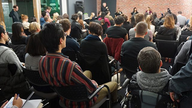 Packed house watches the discussion